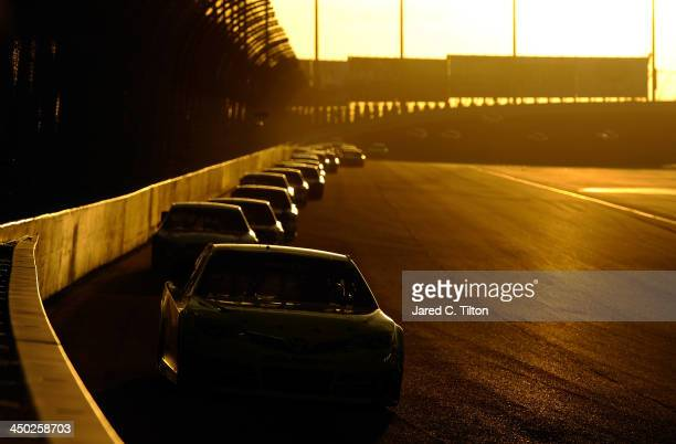Matt Kenseth driver of the Dollar General Toyota leads a pack of cars during the NASCAR Sprint Cup Series Ford EcoBoost 400 at HomesteadMiami...