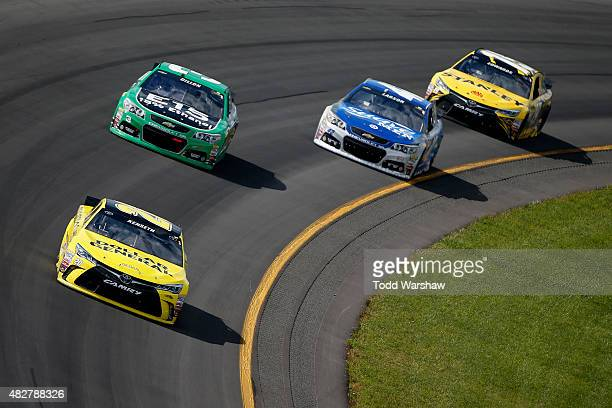 Matt Kenseth, driver of the Dollar General Toyota, leads a pack of cars during the NASCAR Sprint Cup Series Windows 10 400 at Pocono Raceway on...