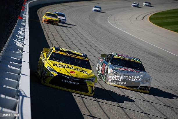 Matt Kenseth driver of the Dollar General Toyota leads a pack of cars during the NASCAR Sprint Cup Series myAFibRiskcom 400 at Chicagoland Speedway...