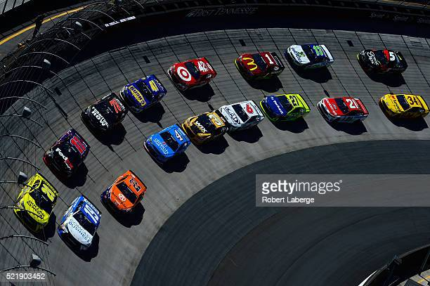 Matt Kenseth driver of the Dollar General Toyota leads the field in a restart during the NASCAR Sprint Cup Series Food City 500 at Bristol Motor...