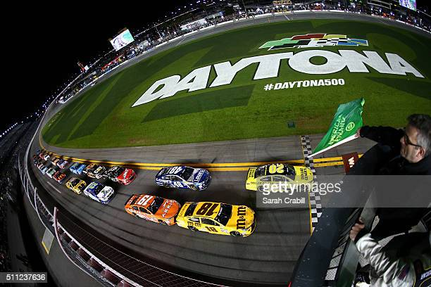 Matt Kenseth driver of the Dollar General Toyota leads the field to the green flag to start the NASCAR Sprint Cup Series CanAm Duels at Daytona...