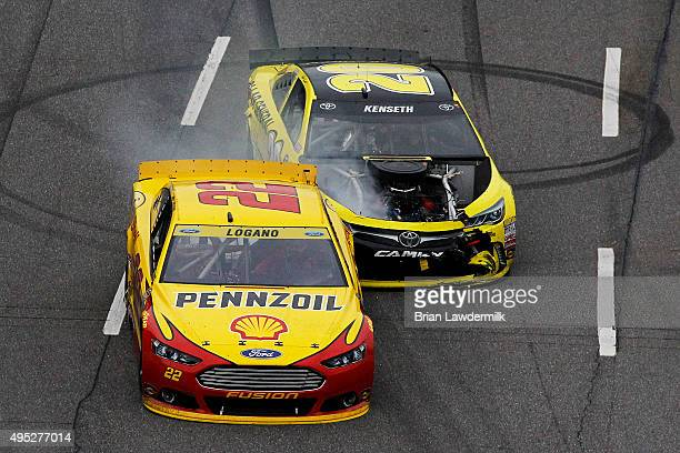 Matt Kenseth, driver of the Dollar General Toyota, makes contact with Joey Logano, driver of the Shell Pennzoil Ford, during the NASCAR Sprint Cup...