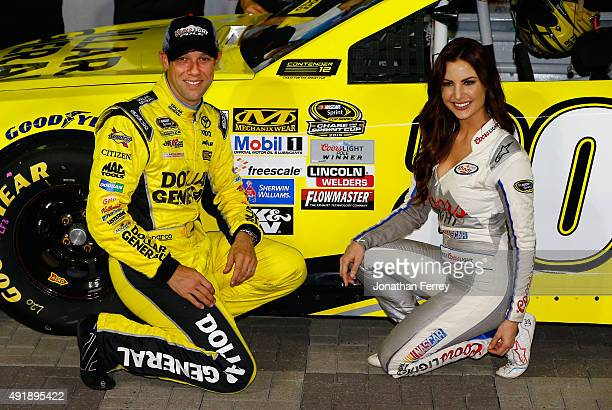 Matt Kenseth driver of the Dollar General Toyota poses for photos with Miss Coors Light Amanda Mertz after winning the Coors Light Pole Award for the...