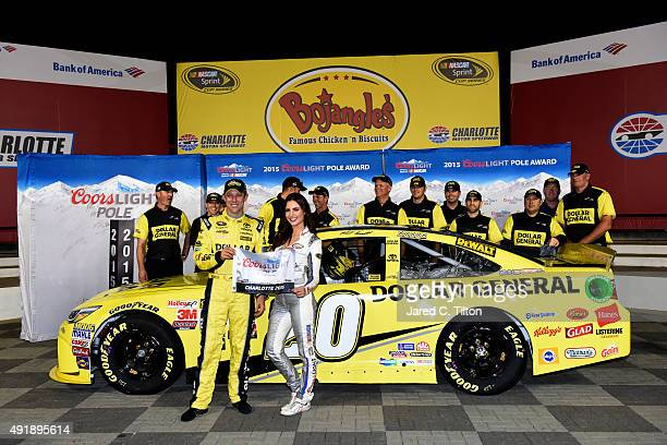 Matt Kenseth driver of the Dollar General Toyota poses with Miss Coors Light Amanda Mertz and the Coors Light Pole Award after qualifying for pole...