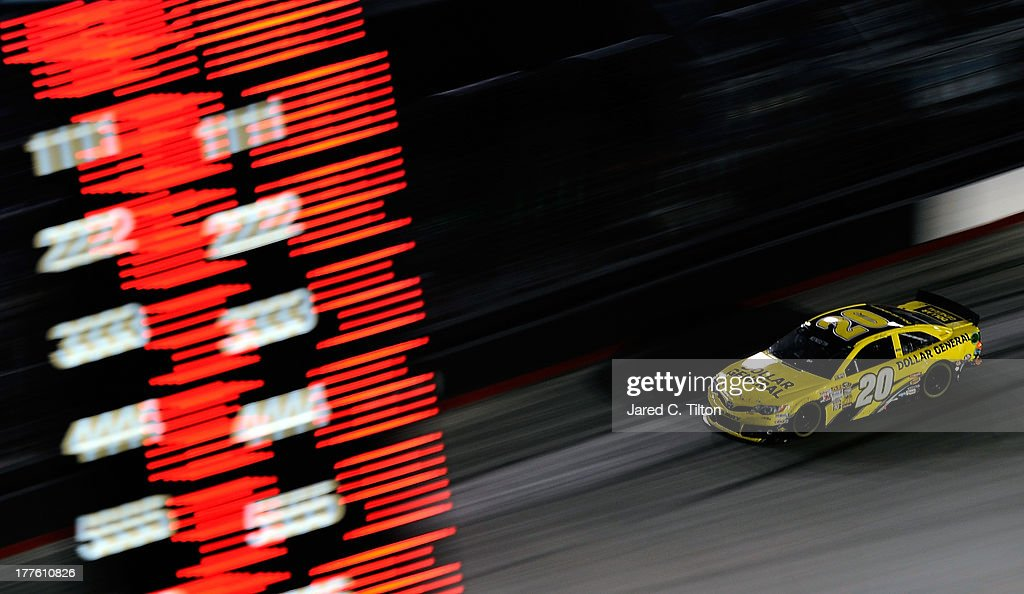Matt Kenseth, driver of the #20 Dollar General Toyota, races during the NASCAR Sprint Cup Series 53rd Annual IRWIN Tools Night Race at Bristol Motor Speedway on August 24, 2013 in Bristol, Tennessee.