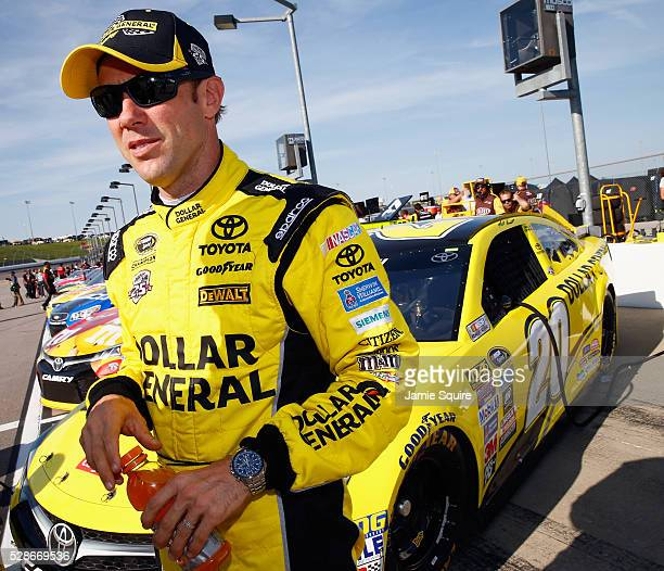 Matt Kenseth driver of the Dollar General Toyota stands on the grid during qualifying for the NASCAR Sprint Cup Series Go Bowling 400 at Kansas...