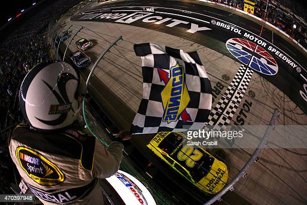 Matt Kenseth driver of the Dollar General Toyota takes the checkered flag to win the NASCAR Sprint Cup Series Food City 500 at Bristol Motor Speedway...