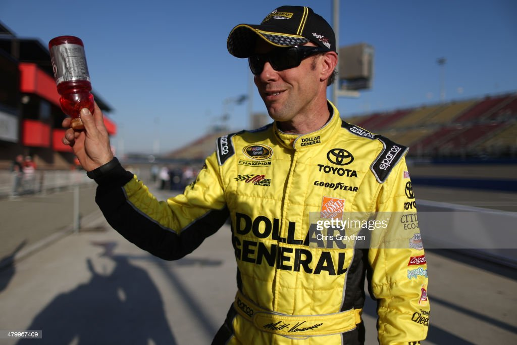 Matt Kenseth, driver of the #20 Dollar General Toyota, walks down pit road after qualifying for the NASCAR Sprint Cup Series Auto Club 400 at Auto Club Speedway on March 21, 2014 in Fontana, California.