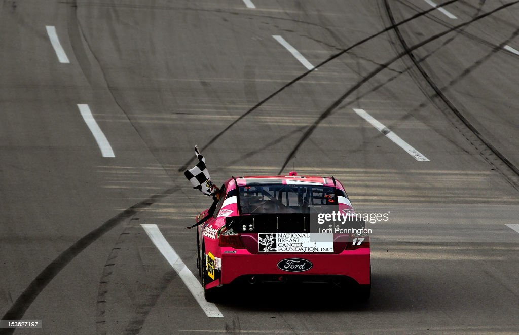 Matt Kenseth, driver of the #17 Ford Ecoboost/National Breast Cancer Foundation Ford, celebrates with the checkered flag after winning the NASCAR Sprint Cup Series Good Sam Roadside Assistance 500 at Talladega Superspeedway on October 7, 2012 in Talladega, Alabama.