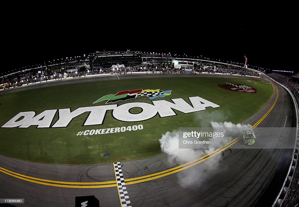 Matt Kenseth, driver of the #18 GameStop Toyota, performs a burnout in celebration of winning the NASCAR Nationwide Series Subway Firecracker 250 at Daytona International Speedway on July 5, 2013 in Daytona Beach, Florida.