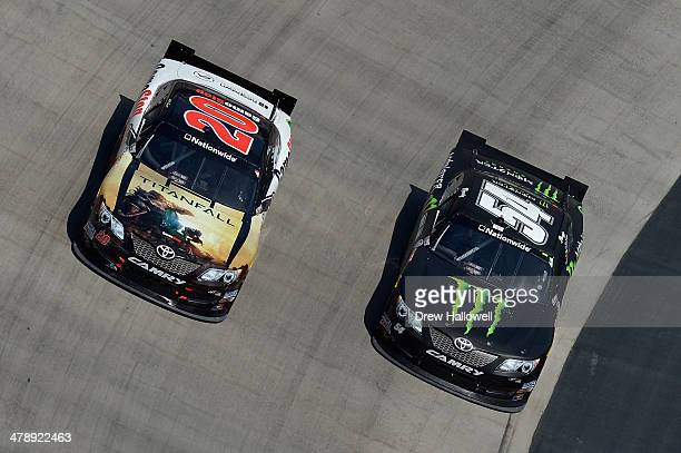 Matt Kenseth driver of the GameStop Toyota races Kyle Busch driver of the Monster Energy Toyota during the NASCAR Nationwide Series Drive To Stop...