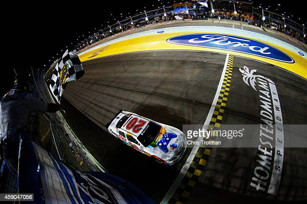 Matt Kenseth driver of the GameStop/Rock Candy Toyota takes the checkered flag to win the NASCAR Nationwide Series Ford EcoBoost 300 at...