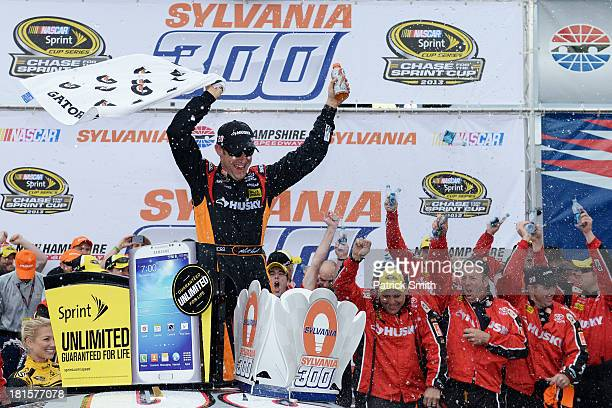 Matt Kenseth driver of the Home Depot / Husky Toyota celebrates in Victory Lane after wining the NASCAR Sprint Cup Series Sylvania 300 at New...