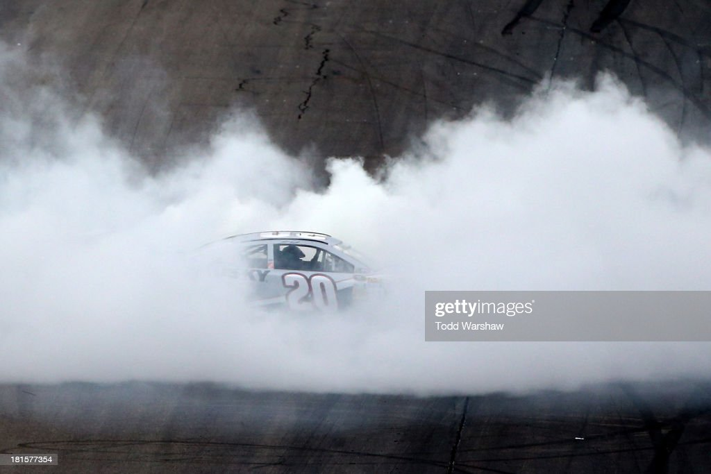 Matt Kenseth, driver of the #20 Home Depot / Husky Toyota, celebrates with a burnout after winning the NASCAR Sprint Cup Series Sylvania 300 at New Hampshire Motor Speedway on September 22, 2013 in Loudon, New Hampshire.
