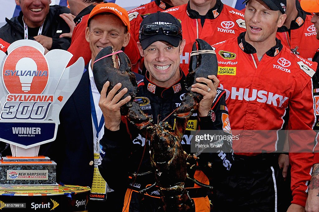 Matt Kenseth, driver of the #20 Home Depot / Husky Toyota, celebrates with the lobster trophy in Victory Lane after winning the NASCAR Sprint Cup Series Sylvania 300 at New Hampshire Motor Speedway on September 22, 2013 in Loudon, New Hampshire.
