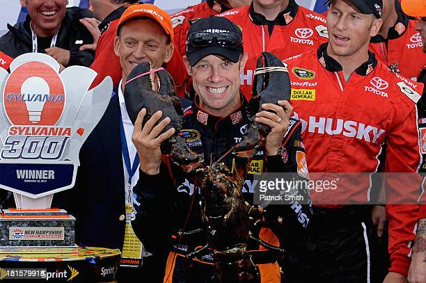 Matt Kenseth, driver of the Home Depot / Husky Toyota, celebrates with the lobster trophy in Victory Lane after winning the NASCAR Sprint Cup Series...