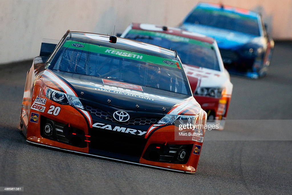 Matt Kenseth, driver of the #20 Home Depot Husky Toyota, leads a pack of cars during the NASCAR Sprint Cup Series Toyota Owners 400 at Richmond International Raceway on April 26, 2014 in Richmond, Virginia.