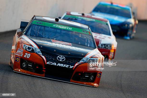 Matt Kenseth driver of the Home Depot Husky Toyota leads a pack of cars during the NASCAR Sprint Cup Series Toyota Owners 400 at Richmond...