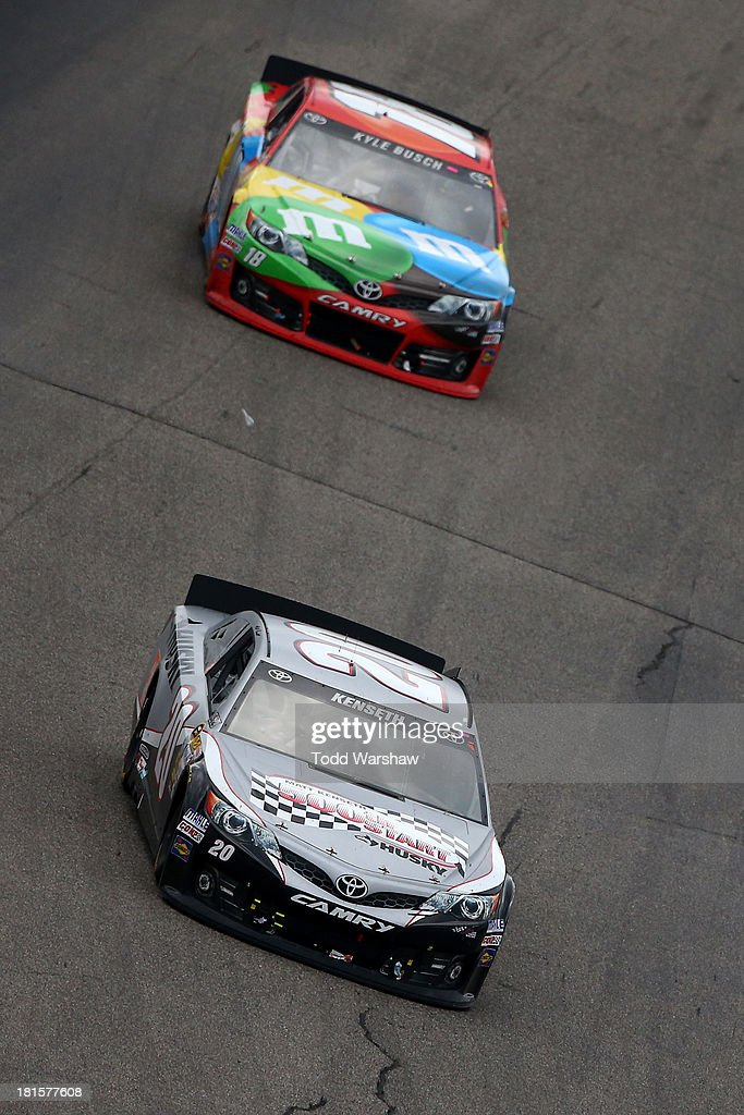 Matt Kenseth, driver of the #20 Home Depot / Husky Toyota, leads Kyle Busch, driver of the #18 M&M's Peanut Butter Toyota, during the NASCAR Sprint Cup Series Sylvania 300 at New Hampshire Motor Speedway on September 22, 2013 in Loudon, New Hampshire.