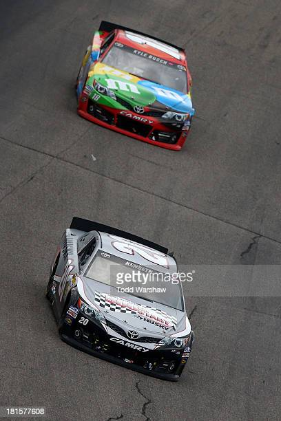 Matt Kenseth driver of the Home Depot / Husky Toyota leads Kyle Busch driver of the MM's Peanut Butter Toyota during the NASCAR Sprint Cup Series...