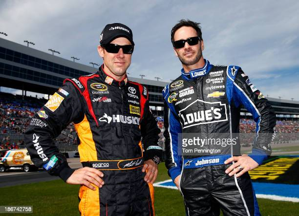 """Matt Kenseth, driver of the Home Depot """"Let's Do This"""" Toyota, and Jimmie Johnson, driver of the Lowe's Chevrolet, pose before the NASCAR Sprint Cup..."""