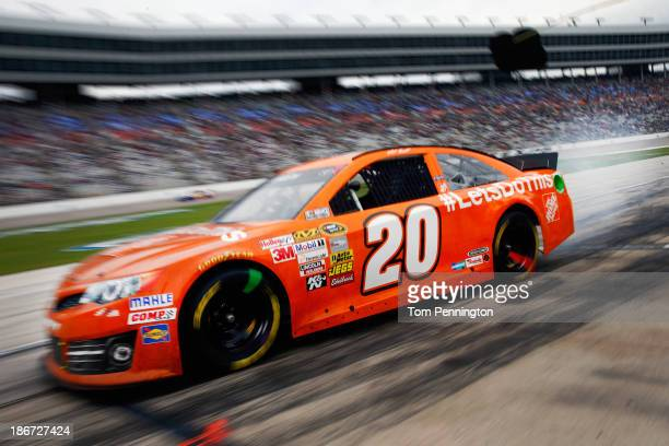 """Matt Kenseth, driver of the Home Depot """"Let's Do This"""" Toyota, drives down pit road during the NASCAR Sprint Cup Series AAA Texas 500 at Texas Motor..."""