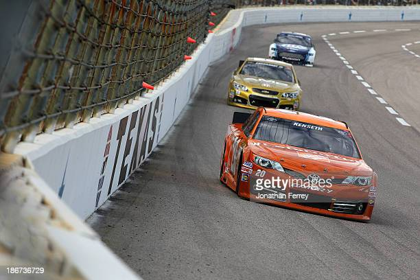 """Matt Kenseth, driver of the Home Depot """"Let's Do This"""" Toyota, leads a pack of cars during the NASCAR Sprint Cup Series AAA Texas 500 at Texas Motor..."""