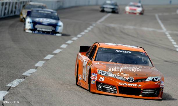 """Matt Kenseth, driver of the Home Depot """"Let's Do This"""" Toyota, leads Brad Keselowski, driver of the Miller Lite Ford, during the NASCAR Sprint Cup..."""