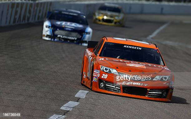 """Matt Kenseth, driver of the Home Depot """"Let's Do This"""" Toyota, leads Brad Keselowski, driver of the Miller Lite Ford, and Dale Earnhardt Jr., driver..."""