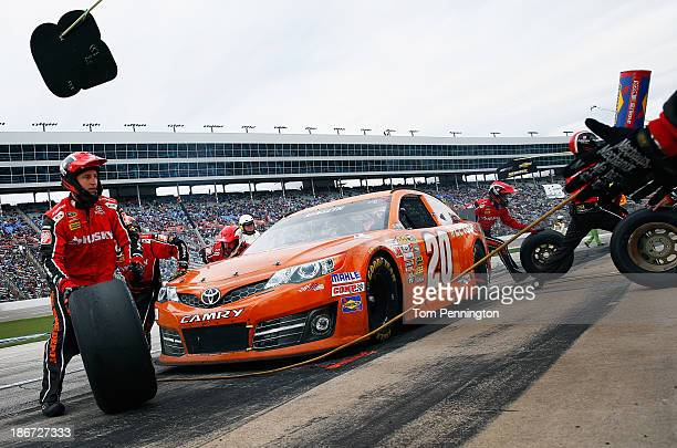 """Matt Kenseth, driver of the Home Depot """"Let's Do This"""" Toyota, pits during the NASCAR Sprint Cup Series AAA Texas 500 at Texas Motor Speedway on..."""