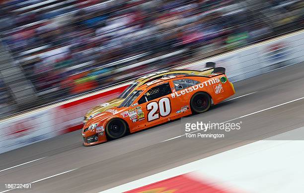 """Matt Kenseth, driver of the Home Depot """"Let's Do This"""" Toyota, races Dale Earnhardt Jr., driver of the AMP Energy Gold / 7-Eleven Chevrolet, during..."""