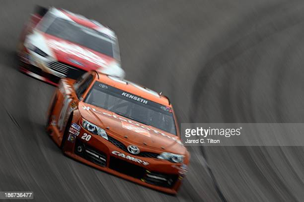 """Matt Kenseth, driver of the Home Depot """"Let's Do This"""" Toyota, races during the NASCAR Sprint Cup Series AAA Texas 500 at Texas Motor Speedway on..."""