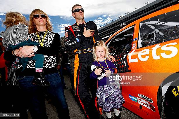 """Matt Kenseth, driver of the Home Depot """"Let's Do This"""" Toyota, stands with wife Katie and daugheters Kaylin Nicola and Grace on the grid during..."""