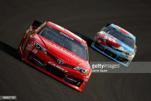Matt Kenseth driver of the Home Depot/Husky Toyota leads Kyle Busch driver of the MM's RedWhiteBlue MProve America Toyota during the NASCAR Sprint...
