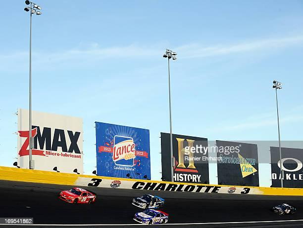 Matt Kenseth driver of the Home Depot/Husky Toyota leads Landon Cassill driver of the ShopBicycleCardscom/Little Joe's Autos Chevrolet Kasey Kahne...