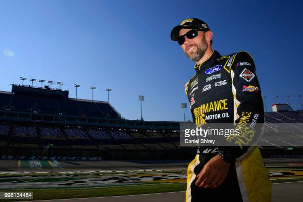 Matt Kenseth driver of the Performance Plus Motor Oil Ford walks on the grid during qualifying for the Monster Energy NASCAR Cup Series Quaker State...