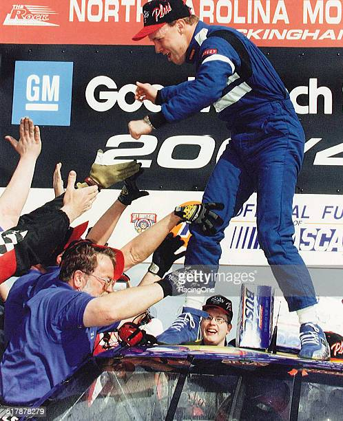 Matt Kenseth driver of the Reiser Enterprises Chevrolet celebrates in victory lane after winning the 1998 GM Goodwrench Service Plus 200 at the North...