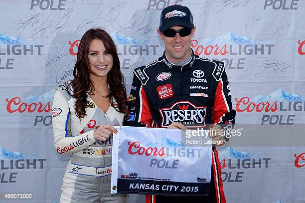 Matt Kenseth driver of the Reser's Main St Bistro Toyota poses with Miss Coors Light Amanda Mertz and the Coors Light Pole award after qualifying for...