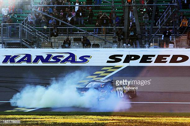 Matt Kenseth driver of the Reser's Toyota celebrates with a burnout after winning the NASCAR Nationwide Series 13th Annual Kansas Lottery 300 at...