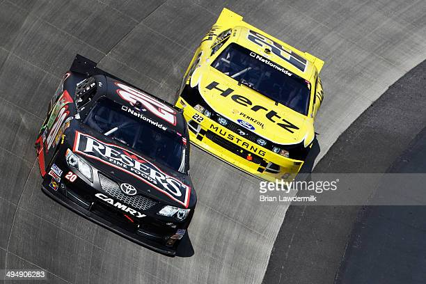 Matt Kenseth driver of the Resers Toyota leads Joey Logano driver of the Hertz Ford during the NASCAR Nationwide Series Buckle Up 200 Presented By...