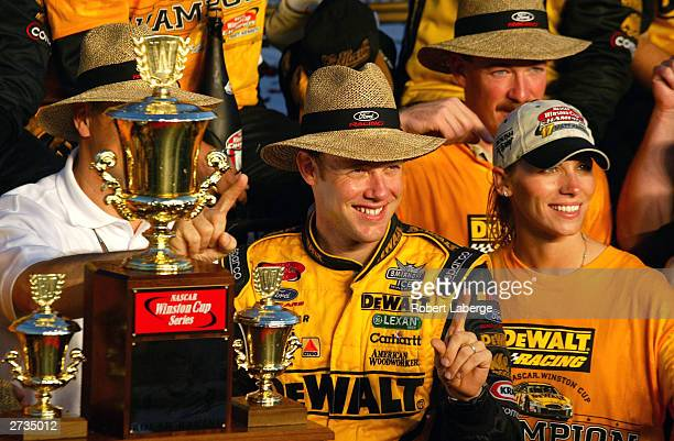 Matt Kenseth driver of the Roush Racing DeWalt Power Tools Ford celebrates with his crew and his wife Katie after winning the NASCAR Winston Cup...