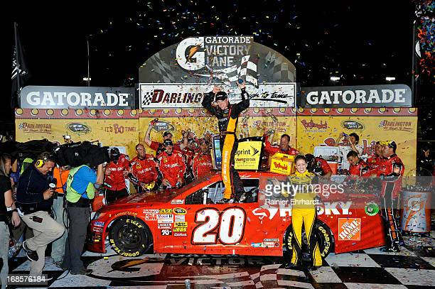Matt Kenseth driver of the The Home Depot / Husky Toyota celebrates with his crew in victory lane after winning the NASCAR Sprint Cup Series...