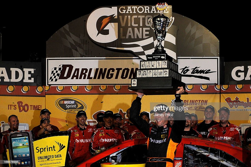 Matt Kenseth, driver of the #20 The Home Depot / Husky Toyota, celebrates with the trophy and his crew in victory lane after winning the NASCAR Sprint Cup Series Bojangles' Southern 500 at Darlington Raceway on May 11, 2013 in Darlington, South Carolina.