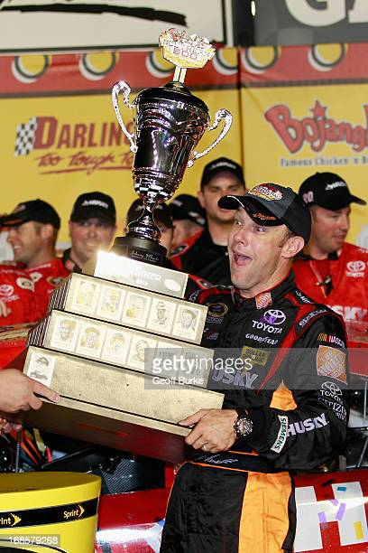 Matt Kenseth driver of the The Home Depot / Husky Toyota celebrates with the trophy in victory lane after winning during the NASCAR Sprint Cup Series...
