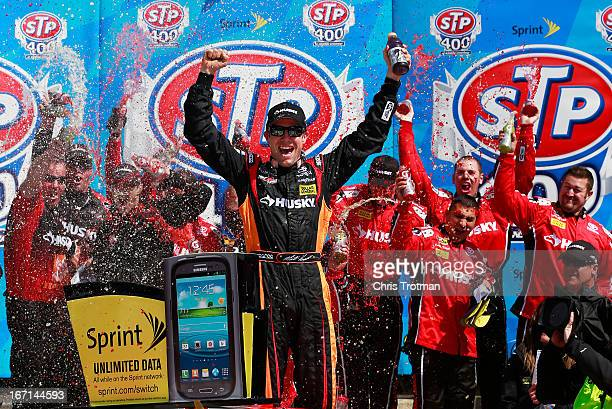 Matt Kenseth driver of the The Home Depot/Husky Toyota celebrates in Victory Lane after winning the NASCAR Sprint Cup Series STP 400 at Kansas...