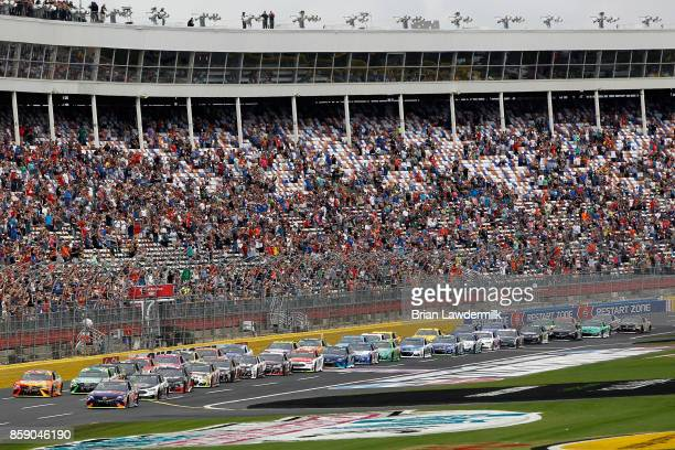 Matt Kenseth driver of the Tide Pods Toyota and Denny Hamlin driver of the FedEx Office Toyota lead the field at the start of the Monster Energy...