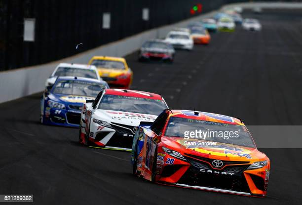 Matt Kenseth driver of the Tide Pods Toyota leads a pack of cars during the Monster Energy NASCAR Cup Series Brickyard 400 at Indianapolis...