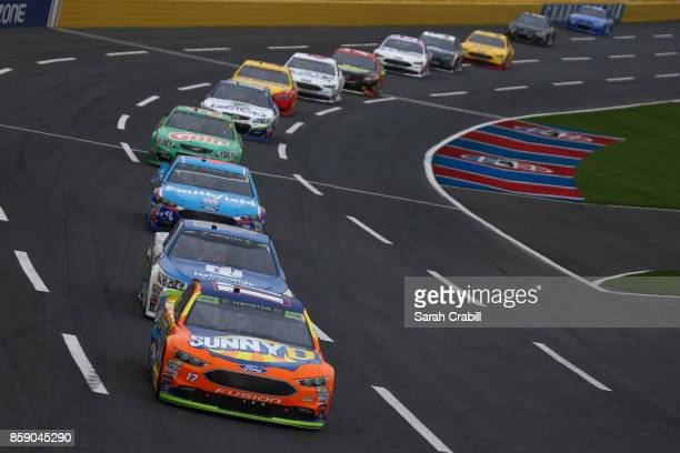 Matt Kenseth driver of the Tide Pods Toyota leads a pack of cars during the Monster Energy NASCAR Cup Series Bank of America 500 at Charlotte Motor...