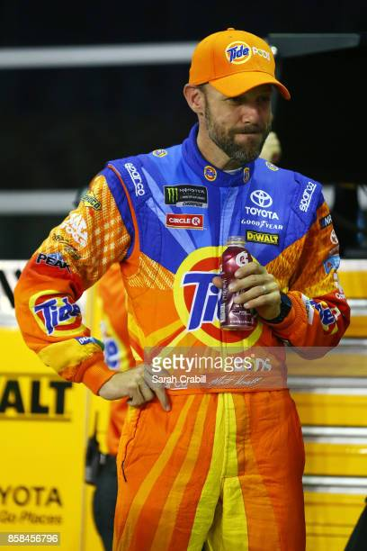 Matt Kenseth driver of the Tide Pods Toyota stands on the grid during qualifying for the Monster Energy NASCAR Cup Series Bank of America 500 at...