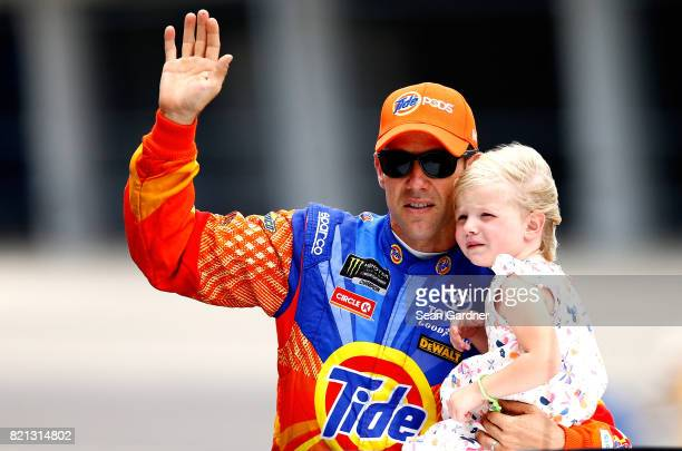 Matt Kenseth driver of the Tide Pods Toyota waves to the crowd prior to the start of the Monster Energy NASCAR Cup Series Brickyard 400 at...